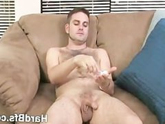 Handsome naughty vidz guy sitting  super on the couch jerking off really hard