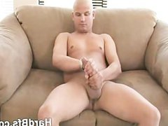 Horny guy vidz strips and  super strokes his dong