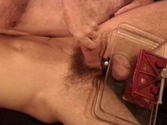 I crush vidz a young  super super HUNG dudes big balls in a vise as a jack him off.