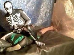 fantasy scene vidz where spandex  super skeleton wrestles and humps frogman