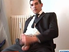 Suitetrouser guy vidz gets wanked  super his very huge cock by a guy despite of him!
