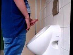 Jerking at vidz the urinal