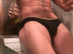 Gropping and vidz teasing his  super bulge on tight briefs