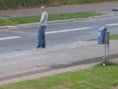 Guy Pisses vidz at the  super Bus Stop