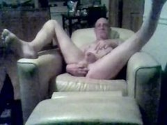 old man vidz playing with  super a toy inthe lving room