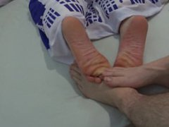playing barefoot vidz footsies with  super my best friend