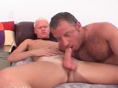 Two hot vidz gay are  super half naked on a sofa,