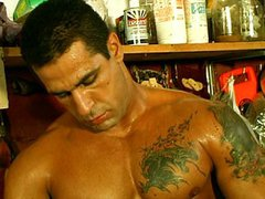 Latin man vidz works himself  super in the garage