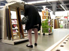 crossdresser ajusting vidz her stockings