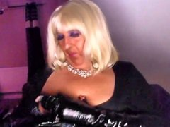 Chrissie smoking vidz a 120  super with black pvc gloves on
