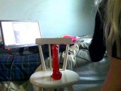 Crossdresser sits vidz on a  super 9 inch dildo