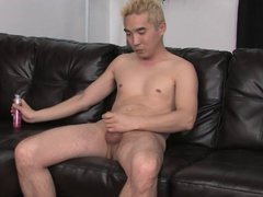 Blonde Asian vidz guy gets  super his cock stiff on a leather couch