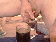 Slow Motion vidz Cumshoot in  super a glass Coffee