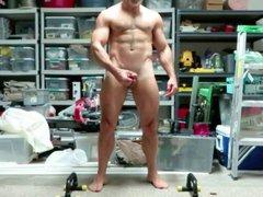Dad practicing vidz his posing  super routine in the garage