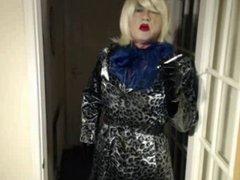 Candi Smokes vidz in her  super pvc shiny coat