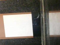 Boy showing vidz off in  super the bathroom
