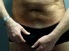 Daddy cums vidz in new  super black nylon panties in swimming pool stall