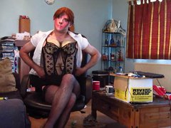 stripping out vidz of a  super secretary outfit to reveal a black basque