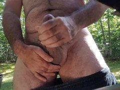 Jerking off vidz outdoors in  super back yard cum shot public