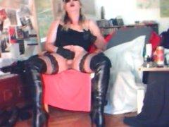 Madame Crudelitas vidz masturbating with  super black pvc thigh boots. 2