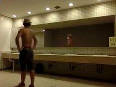 Naughty Asian vidz stroking his  super cock in a public restroom