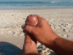 Hung guy vidz jerks his  super huge cock to a big cumshot on the beach