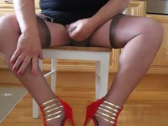 Masturbating in vidz a dress,  super nylons and high heels