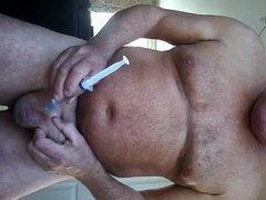 BDSM scrotum vidz filled up  super with water ,injected with a syringe