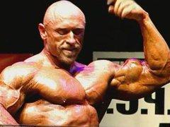 Ripped Bodybuilder vidz Flexes on  super Stage