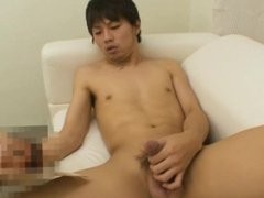 Japanese dude vidz plays with  super his balls and cock until he cums