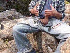 Jerk off vidz session sitting  super on a rock