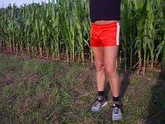 Moving in vidz the fields  super in red Adidas shiny Boyshorts.AVI
