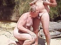Old man vidz sucks another  super man's penis on a beach