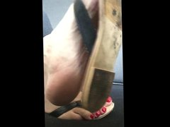 POV soles vidz dangling with  super leather flip flops and red toe nails
