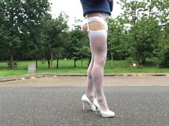 Cross dresser vidz outdoor posing  super in white stockings.