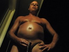 Naked daddy vidz taking a  super pee at night outdoors.