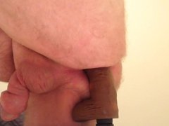 Stroking my vidz pumped cock  super while riding BBC dildo