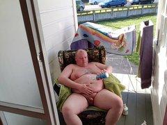 Fat man vidz masturbates by  super a public road.