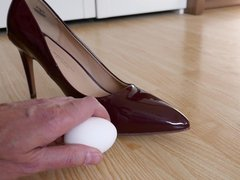 Red stiletto vidz high heels,  super nylons and egg (food mess)