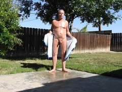 A daddy vidz opening his  super towel and peeing in public.