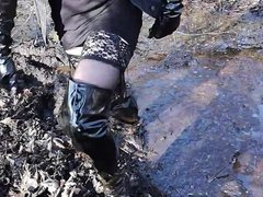 Vinyl over vidz knee boots,  super pantyhose and mini skirt in deep mud!